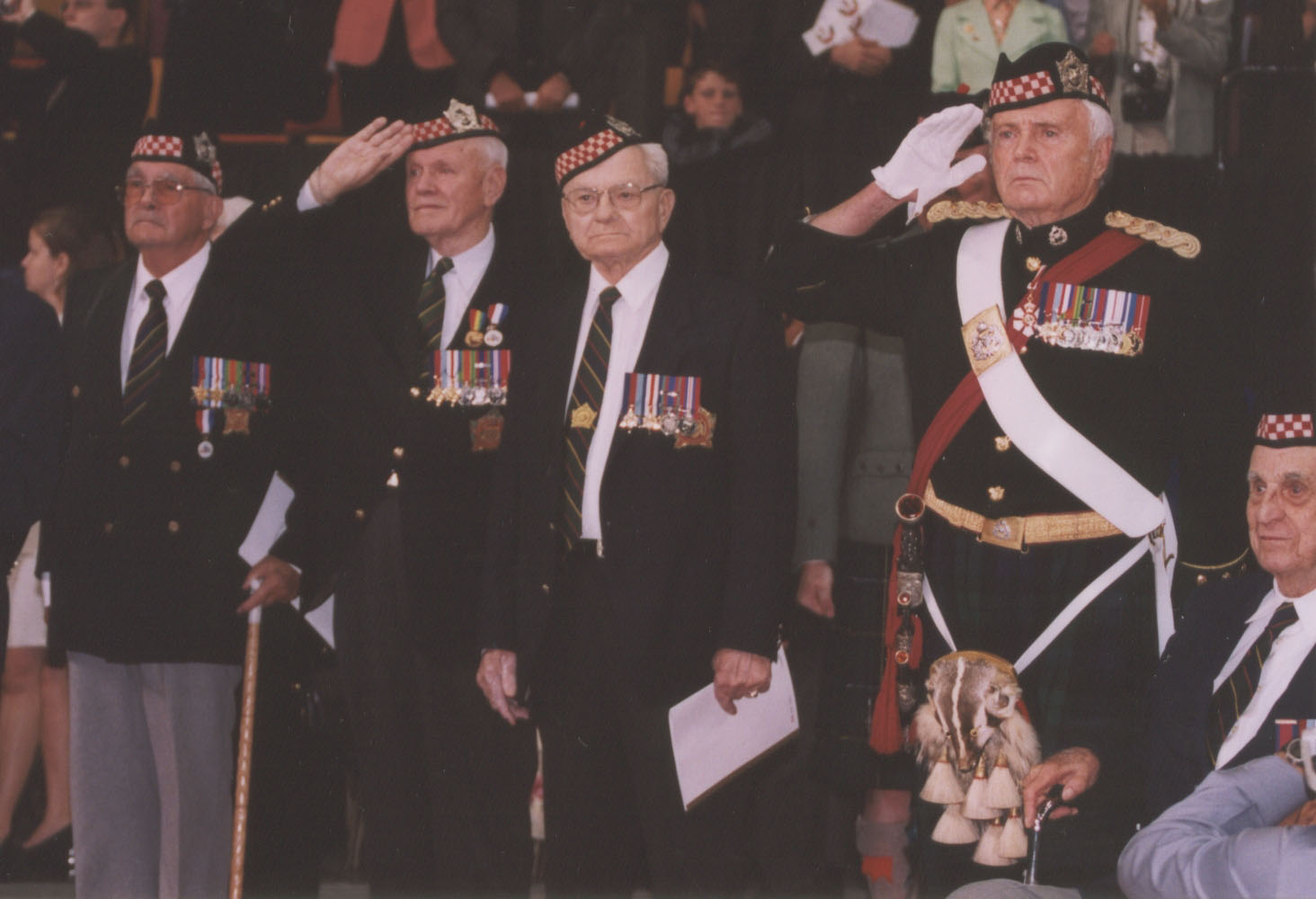 Col Alan Earp, OC, leads Argyll veterans in a salute at the Trooping of the Colours, 2002, at Copps Colisuem